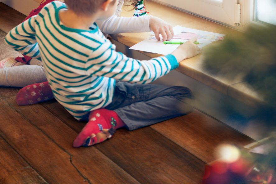 Image of children playing on a wood floor.