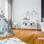 baby room with wood floor