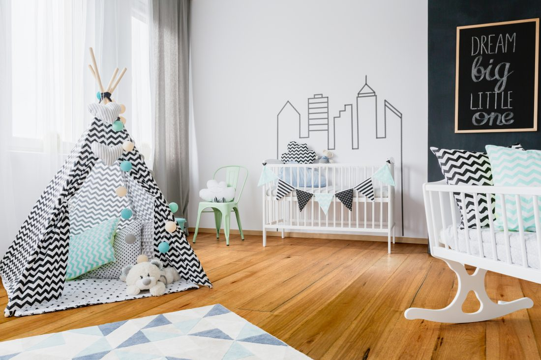 baby room with wood floor