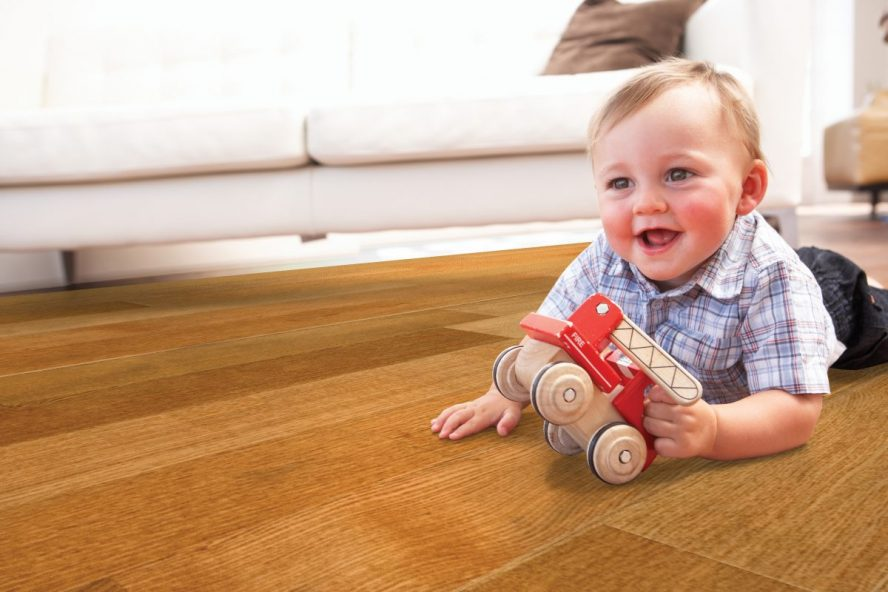 Image showing child playing on a wood floor.