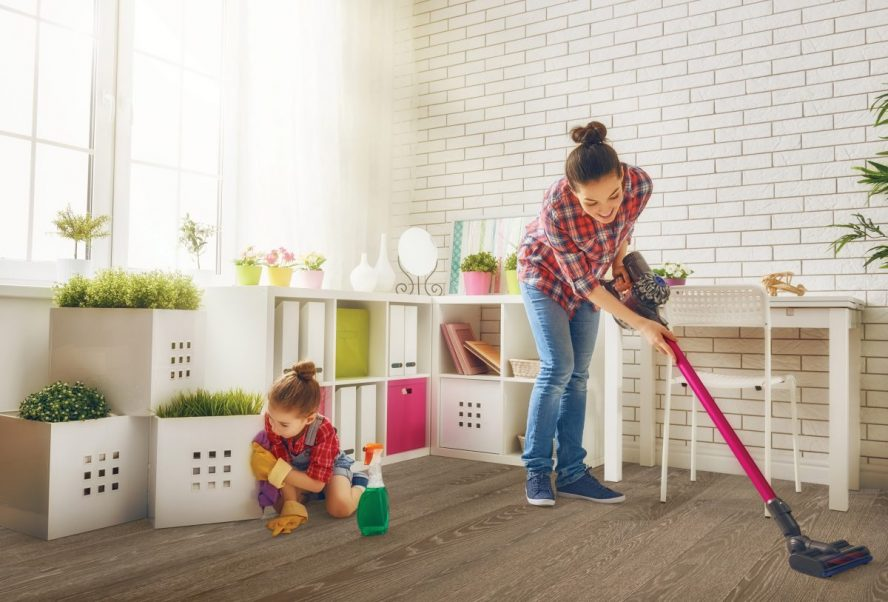 image showing a lady cleaning wood floor.
