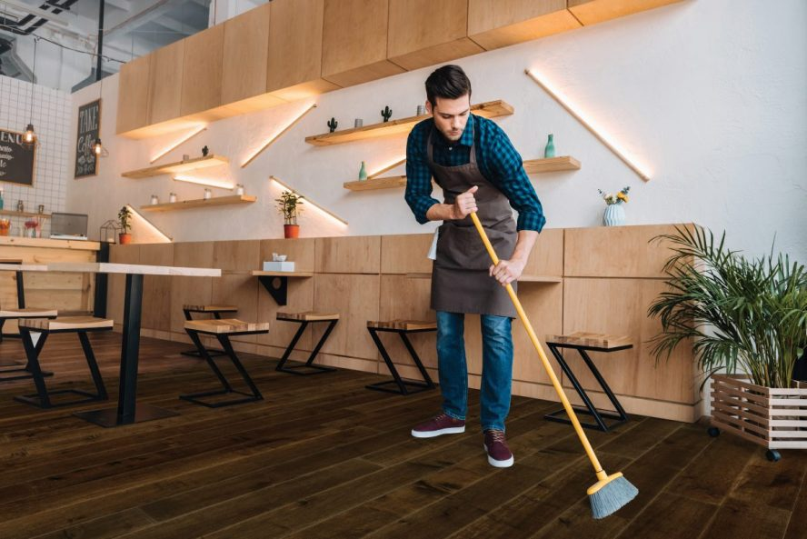 Image showing a man cleaning wood floor.